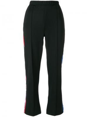 Спортивные брюки с полосками логотипом Être Cécile. Цвет: чёрный