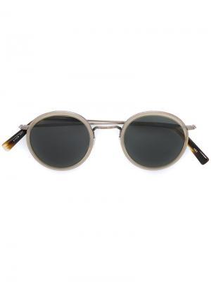 Солнцезащитные очки  с круглой оправой Masunaga. Цвет: телесный