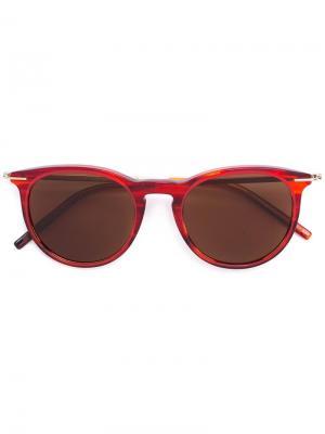 Солнцезащитные очки в круглой оправе Tomas Maier Eyewear. Цвет: красный
