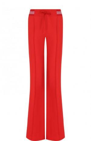 Расклешенные брюки со стрелками и эластичным поясом Valentino. Цвет: красный