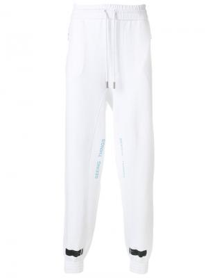 Спортивные брюки с принтом в полоску Off-White. Цвет: белый