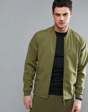 Adidas Зеленая спортивная куртка ZNE B49253. Цвет: зеленый