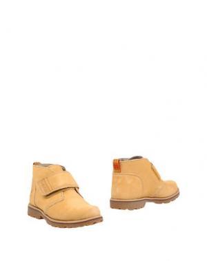 Полусапоги и высокие ботинки TIMBERLAND. Цвет: охра