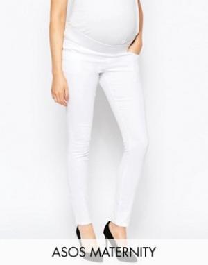 ASOS Maternity Белые джинсы скинни для беременных с посадкой под животом Materni. Цвет: белый