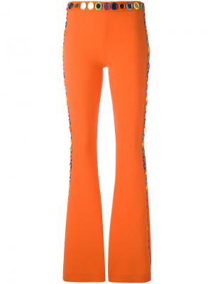 Расклешенные декорированные брюки Moschino. Цвет: жёлтый и оранжевый