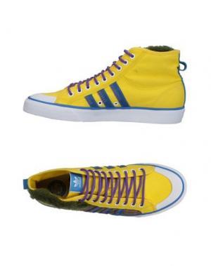 Высокие кеды и кроссовки ADIDAS ORIGINALS. Цвет: желтый