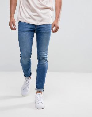 River Island Умеренно выбеленные синие джинсы скинни. Цвет: синий