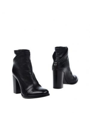 Полусапоги и высокие ботинки SALVADOR RIBES. Цвет: черный