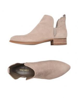 Полусапоги и высокие ботинки NINE WEST. Цвет: бежевый
