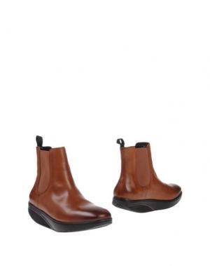 Полусапоги и высокие ботинки MBT. Цвет: коричневый