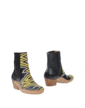 Полусапоги и высокие ботинки MAISON MARGIELA. Цвет: желтый