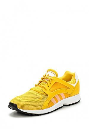 Кроссовки adidas Originals. Цвет: желтый