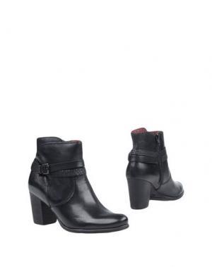 Полусапоги и высокие ботинки NOVELTY. Цвет: черный