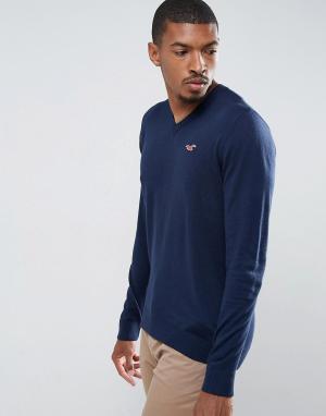 Hollister Темно-синий меланжевый джемпер с V-образным вырезом и логотипом Hollis. Цвет: темно-синий