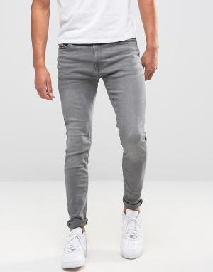 Jack & Jones Серые выбеленные джинсы скинни Intelligence. Цвет: серый