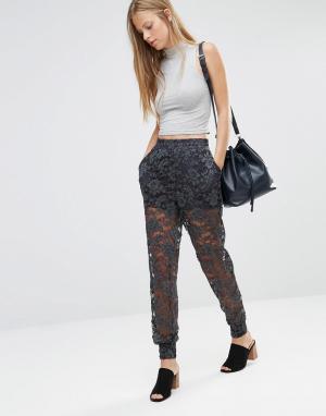 Ganni Кружевные брюки-галифе. Цвет: мульти