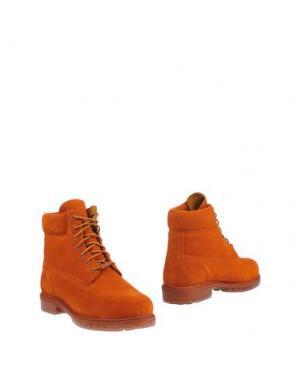 Полусапоги и высокие ботинки TIMBERLAND. Цвет: оранжевый