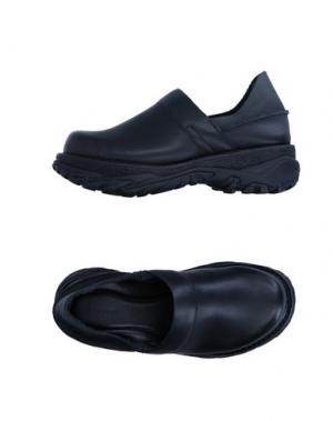 Низкие кеды и кроссовки ZUCCA. Цвет: черный