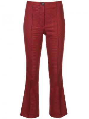 Расклешенные брюки с узором в ломаную клетку Helmut Lang. Цвет: красный