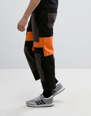 ASOS Свободные укороченные брюки со вставками оранжевого и черного цвета AS. Цвет: черный