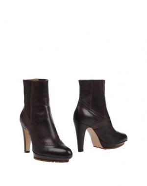 Полусапоги и высокие ботинки NAIF. Цвет: темно-коричневый