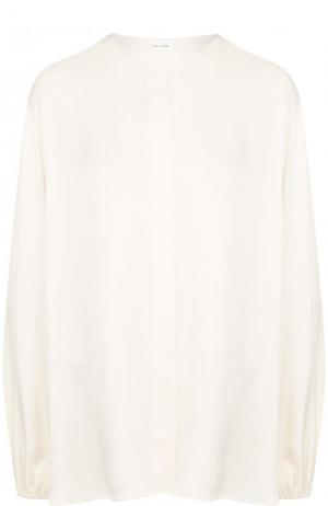 Однотонная шелковая блуза свободного кроя The Row. Цвет: белый