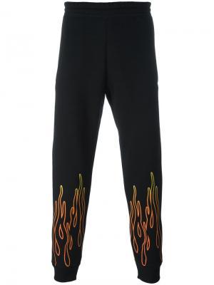 Спортивные брюки с огненным принтом Omc. Цвет: чёрный