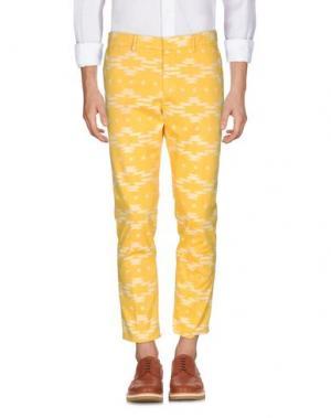 Повседневные брюки THE EDITOR. Цвет: желтый