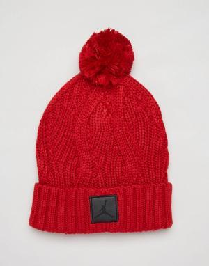 Jordan Красная шапка-бини с помпоном Nike Jumpman 801768-687. Цвет: красный
