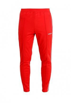 Брюки спортивные adidas Originals. Цвет: красный