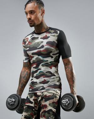 Reebok Компрессионная спортивная футболка с камуфляжным принтом BR9566. Цвет: зеленый