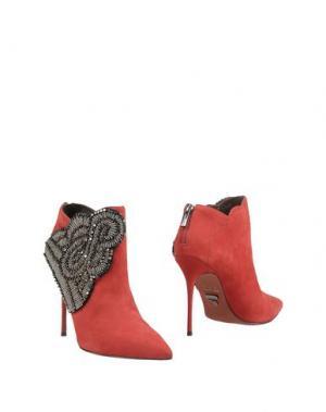 Полусапоги и высокие ботинки CARRANO. Цвет: красный
