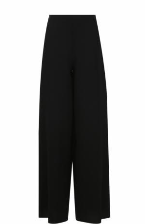 Шерстяные широкие брюки Alaia. Цвет: черный