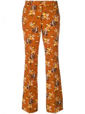 Расклешенные брюки с цветочным узором Coach. Цвет: коричневый