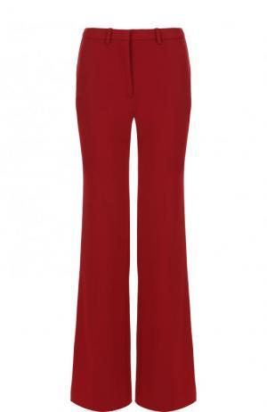 Однотонные расклешенные брюки со стрелками Theory. Цвет: красный