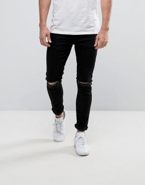 YOURTURN Черные супероблегающие джинсы с рваными коленями. Цвет: черный
