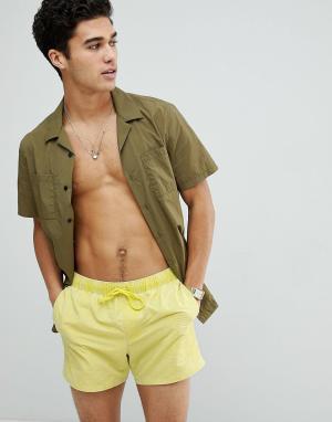 ASOS Желтые короткие шорты для плавания с эффектом кислотной стирки. Цвет: желтый