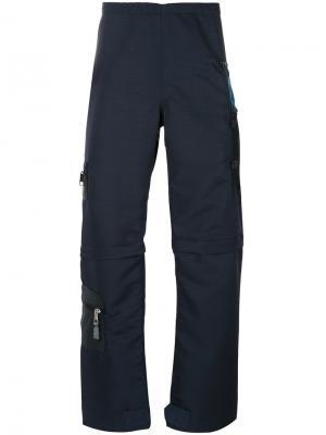 Брюки на молниях с карманами Longjourney. Цвет: синий