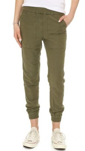 Практичные брюки для бега NLST. Цвет: оливковый