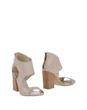 Полусапоги и высокие ботинки SALVADOR RIBES. Цвет: светло-серый