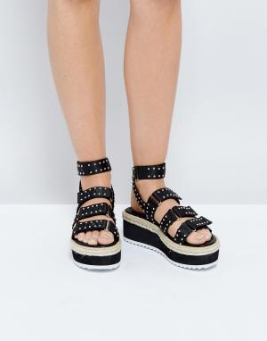 Raid Черные сандалии на плоской платформе с заклепками Renato. Цвет: черный