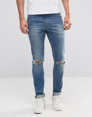 ASOS Синие супероблегающие джинсы с рваными коленками. Цвет: синий