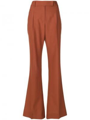 Длинные брюки клеш Prada. Цвет: жёлтый и оранжевый