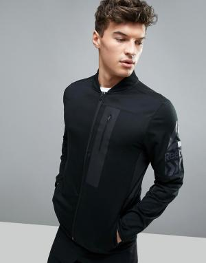 Reebok Черная спортивная куртка Training BK4509. Цвет: черный