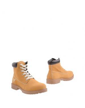 Полусапоги и высокие ботинки AVIREX. Цвет: охра