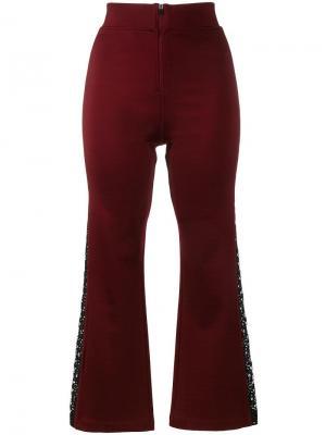 Расклешенные брюки с кружевными вставками Ganni. Цвет: розовый и фиолетовый