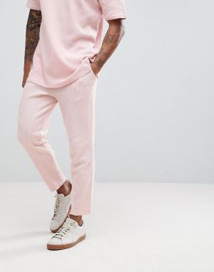 Puma Трикотажные джоггеры с вафельной текстурой. Цвет: розовый