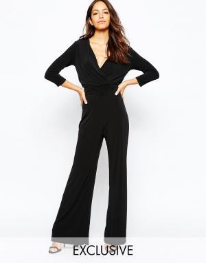 Never Fully Dressed Комбинезон в стиле 70-х с глубоким вырезом и широкими штанинами. Цвет: черный