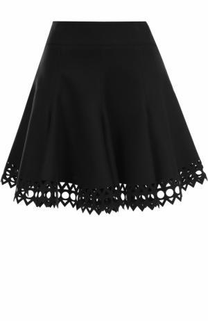 Шерстяная мини-юбка с перфорацией Alaia. Цвет: темно-зеленый