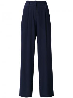 Расклешенные классические брюки Odeeh. Цвет: синий